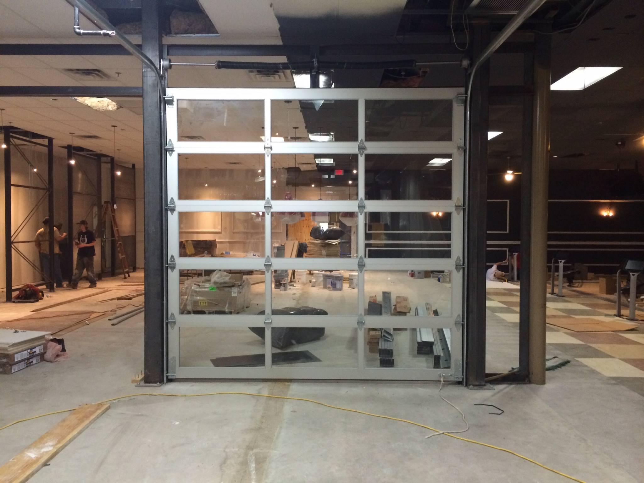 Commercial roll up doors garage door repair houston tx for Garage door repair houston texas